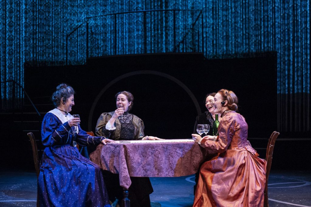 4 women sitting at a table
